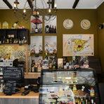 """Точно както Мароко е срещу Испания, така и на отсрещния тротоар срещу мароканския ресторант има съвсем ново изникнал магазин на по-малко от месец за испански деликатеси – La casa Iberica.Това е вторият магазин на същите собственици, първият вече е популярен с качествените си продукти от иберийски полуостров, намира се на ул. Сан Стефано 4. В новото място ни посреща любезната управителка Мина Симеонова, която ни обяснява, че тук всичко е от Испания, дори и минералната вода, с изключение на кафето, което е Dabov. Централно място заема хамонът """"иберико"""", от който се предлага два вида. """"Единият е от месото на черни прасета, хранени само с жълъди, които наддават бавно. Вкусът е специфичен, няма нужда много да се дъвчи, топи се в устата, цената е 18,50 за 100 гр., за този, който не е на бут. Другият вид """"иберико"""" е 50 на 50, половината от храненето е с жълъди, а другата половина е с дохранване. И при двата вида консервантите са сведени до минимум и няма алергени, добавки, лактоза и други подобни"""" казва Мина Симеонова. Тук можете да си купите и хамон на бут, който се продава със стойката. Сирената са Artequeso, Cerrato, Boffard и др.La casa Iberica, ул. Ангел Кънчев 26"""