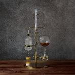 Филтриран сок от портокал с канела, карамфил и джинджър. Нагряването води до образуване на конденз, капка от който пада върху традиционен испански сладкиш с уиски.