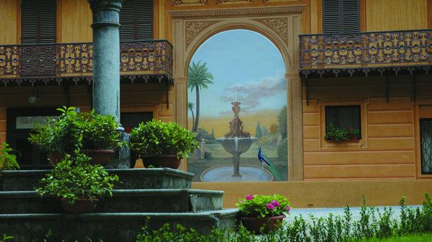 Фонтанът, дал името на компанията, е изрисуван на фасадата на кралската вила